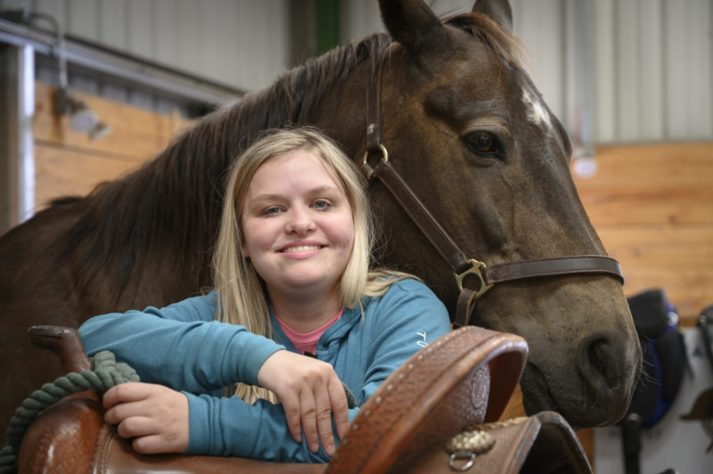 Maddie Engles, pictured with therapy horse Jingo
