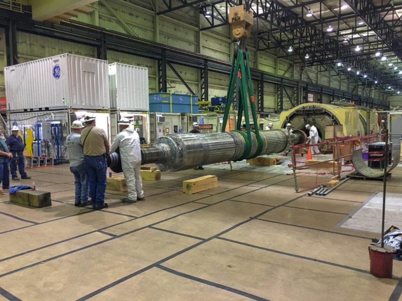 Men working on massive machinery