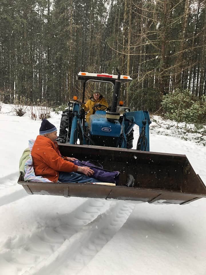 A man helping another man out of the snow