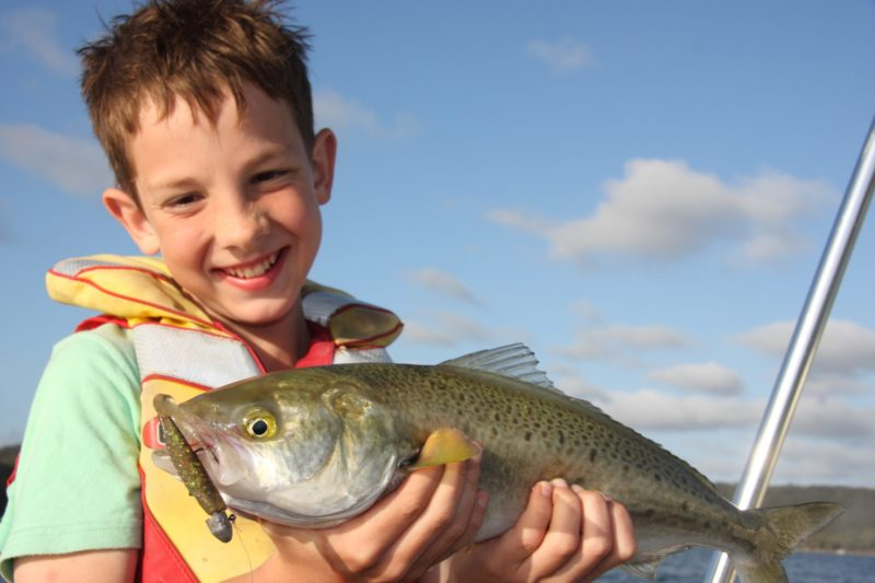 Boy with fish he caught
