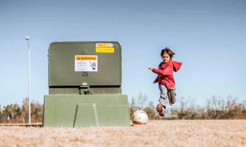 Child playing around transformer